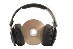 Auriculares en disco compacto Foto de archivo libre de regalías