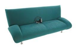 Auriculares en el sofá Fotografía de archivo