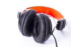Auriculares a escuchar la música Fotos de archivo