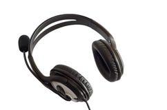 Auriculares negros con un micrófono Fotografía de archivo