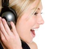 Auriculares que cantan a la muchacha Foto de archivo