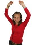 Auriculares que desgastan de la muchacha adolescente linda Fotos de archivo