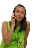 Auriculares que desgastan de la muchacha adolescente linda Fotos de archivo libres de regalías