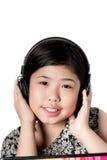 Auriculares que escuchan de la niña Imágenes de archivo libres de regalías
