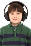 Auriculares sonrientes del niño con el camino de recortes foto de archivo libre de regalías