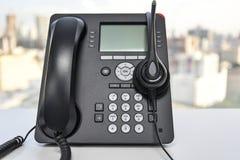 Auriculares y el teléfono del IP Imagen de archivo libre de regalías