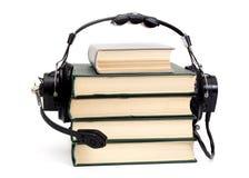 Auriculares y libros Fotografía de archivo libre de regalías