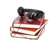 Auriculares y libros fotos de archivo libres de regalías