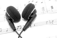 Auriculares y música Fotografía de archivo