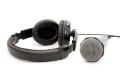 Auriculares y micrófono negros Foto de archivo libre de regalías