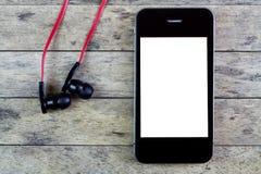 Auriculares y teléfono elegante Imagen de archivo