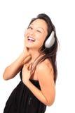 Auriculares y una sonrisa Fotografía de archivo libre de regalías