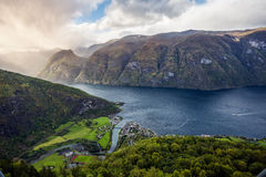 Aurland and Aurlandsfjord in the mist, Sogn og Fjordane, Norway. It is located on the south side of the Sognefjorden in the district of Sogn Royalty Free Stock Photo