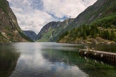 Aurlandsfjord at Gudvangen in Norway. Aurlandsfjord with lake and pier at Gudvangen in Norway Stock Photo