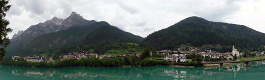 Auronzo di Cadore with lake. This is the town Auronzo di Cadore in the Dolomite. In the foreground is the lake from the dam from Auronzo di Cadore Stock Images