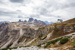 Auronzo refuge and Cadini di Misurina range, Dolomite Alps Royalty Free Stock Images