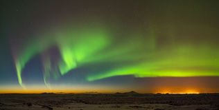 Aurora above Keflavik in Iceland. Royalty Free Stock Images