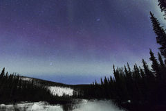 Aurora above the mountain Stock Images