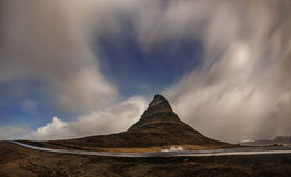 Aurora blasted in sky over Kirkjufell mountain at night, Iceland stock photography