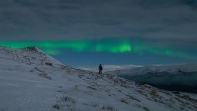 Aurora boreal de observação da mulher Foto de Stock Royalty Free