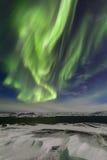 Aurora boreal en la orilla del Océano ártico Foto de archivo libre de regalías