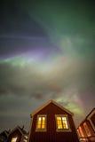 Aurora borealis above house, Lofoten islands, Norway Stock Photos