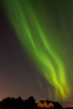 Aurora borealis above houses of old Reykjavík Royalty Free Stock Images