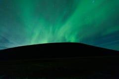 Aurora borealis above a mountain Stock Photo