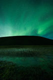 Aurora borealis above a mountain Stock Image