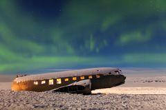 Aurora borealis above the plane in Iceland. Green northern lights. Starry sky with polar lights. Aurora borealis above the plane. Green northern lights. Starry royalty free stock image
