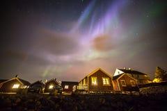 Aurora borealis above village, Lofoten islands, Norway Stock Photos