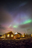 Aurora borealis above village, Lofoten islands, Norway Royalty Free Stock Photo