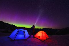Aurora Borealis And Tents On Snow Mountain Royalty Free Stock Photography