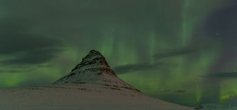 Aurora Borealis around Kirkjufell Mountain Stock Photography