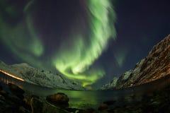 Aurora borealis au-dessus de lentille de fisheye de Tromso Photo libre de droits
