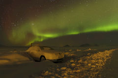 Aurora Borealis and a car in the snow Royalty Free Stock Image