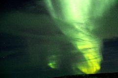 Aurora Borealis on a cloudy night Royalty Free Stock Images