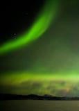 Aurora borealis dancing over frozen Lake Laberge Yukon Canada Royalty Free Stock Photo