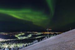 Aurora borealis dans la station de sports d'hiver de Lévi, Finlande Images stock