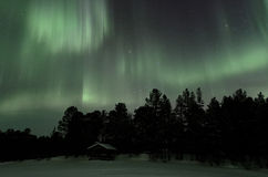 Aurora borealis falls on lake. Just  sec shot to catch this amazing northern light in lapland Stock Image