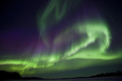 Aurora Borealis in finnish Lapland. Aurora Borealis with green and purple light at Inari lake, finland, Lapland, natural spectacle at night Stock Photography