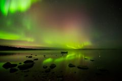Aurora Borealis on Foggy Lake Royalty Free Stock Photography