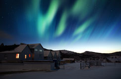 Aurora borealis. Houses and northern lights (aurora borealis) in Greenland