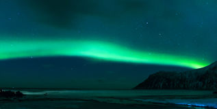 Aurora Borealis Known as Norther Lights Playing with Vivid Colors Over Lofoten Islands in Norway Royalty Free Stock Photography