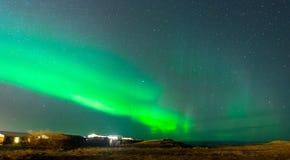 Aurora Borealis, Northern lights in Iceland. Aurora Borealis, known as Northern lights, is amazing green color light over night sky in high lattitude region Stock Photos