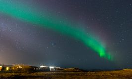 Aurora Borealis, Northern lights in Iceland. Aurora Borealis, known as Northern lights, is amazing green color light over night sky in high lattitude region Royalty Free Stock Photos