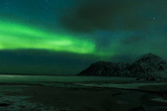 Aurora Borealis Known as Northern Lights Playing with Vivid Colors Over Lofoten Islands Stock Photo