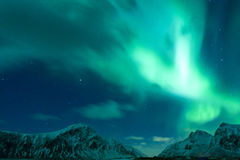 Aurora Borealis Known as Nother Lights Playing with Vivid Colors Over Lofoten Islands Stock Photo