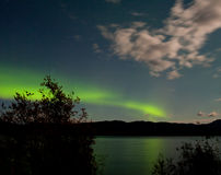 Aurora borealis moon-lit clouds over Lake Laberge stock photography