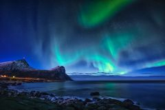 Aurora borealis on sky in Norway. The aurora borealis on the night sky in Northern Norway Stock Photo